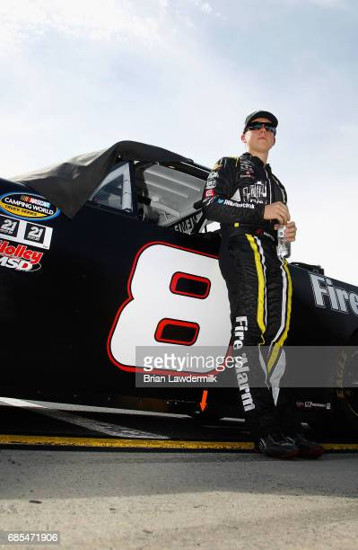 John H Nemechek driver of the NEMCO Motorsports Chevrolet stands by his car during qualifying for the Camping World Truck Series North Carolina...