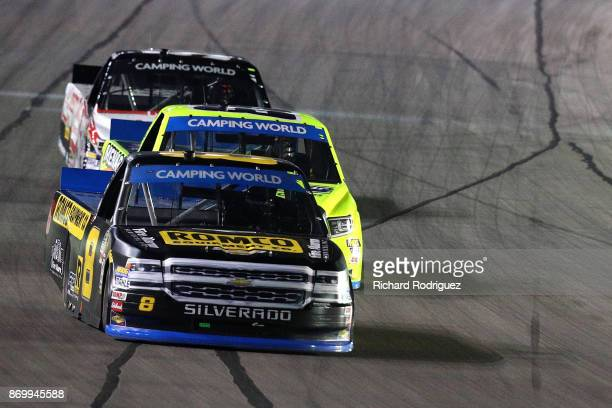 John H Nemechek driver of the ROMCO Equipment/Fire Alarm Services Chevrolet leads Matt Crafton driver of the Ideal Door/Menards Toyota and Justin...