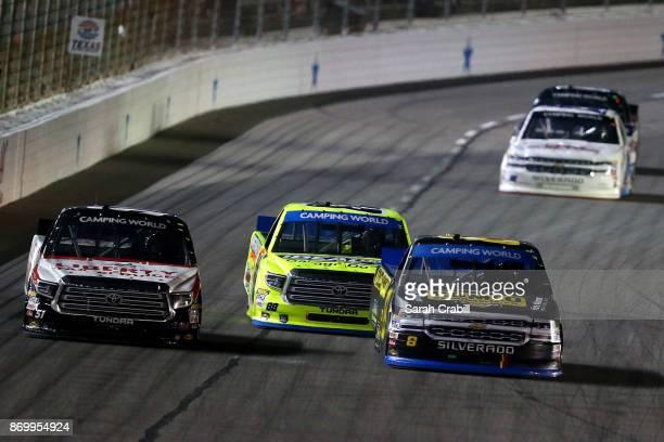 John H Nemechek driver of the ROMCO Equipment/Fire Alarm Services Chevrolet leads Matt Crafton driver of the Ideal Door/Menards Toyota and Myatt...
