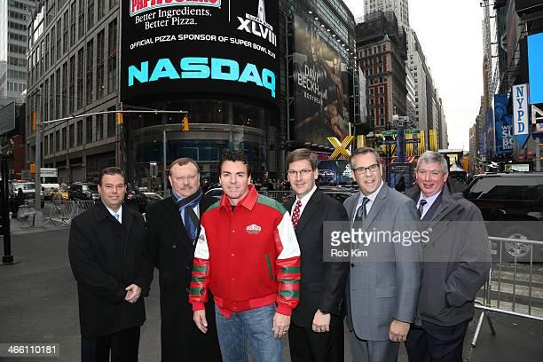 John H Schnatter Founder Chairman CEO of Papa John's International Inc and his team visit the NASDAQ Opening Bell at NASDAQ MarketSite on January 31...