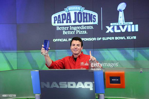 John H Schnatter Founder Chairman CEO of Papa John's International Inc rings the NASDAQ Opening Bell at NASDAQ MarketSite on January 31 2014 in New...