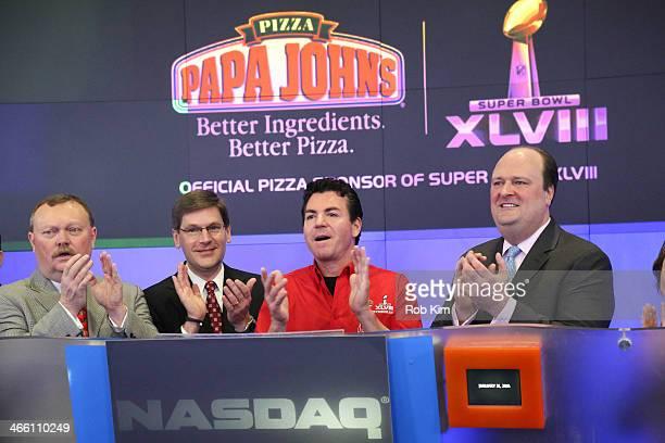 John H Schnatter Founder Chairman CEO of Papa John's International Inc with David Wicks of Nasdaq and representatives of Papa John's ring the NASDAQ...