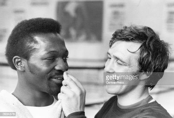 John H Stracey wipes the sweat from the face of Maurice Hope The two boxers are training at the Royal Oak Canning Town in preparation for two...