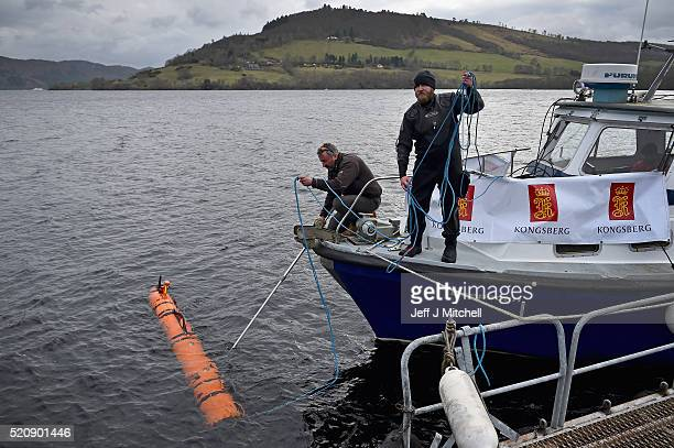 John Haig an engineer moves a Munin robot operated by Norwegian company Kongsberg Maritime in Loch Ness on April 13 2016 in Drumnadrochit Scotland...