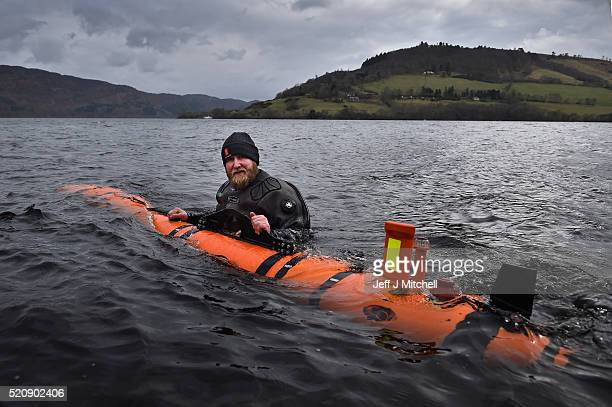 John Haig an engineer moves a Munin robot, operated by Norwegian company Kongsberg Maritime in Loch Ness on April 13, 2016 in Drumnadrochit, Scotland...