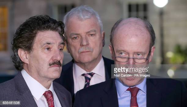 John Halligan Finian McGrath and Shane Ross of the Independent Alliance hold a press conference on the plinth at Leinster House in Dublin after their...