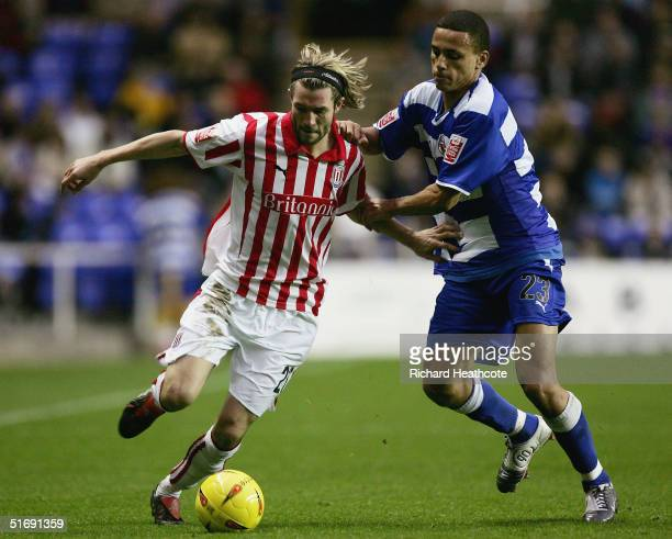 John Halls of Stoke holds off Reading's Dean Morgan during the CocaCola Championship match between Reading and Stoke City at the Madejski Stadium on...