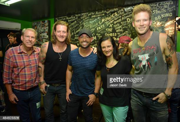 John Hamlin of CMT Tyler Hubbard of Florida Georgia Line Cody Alan of CMT Leslie Fram of CMT and Brian Kelley of Florida Georgia Line pose backstage...