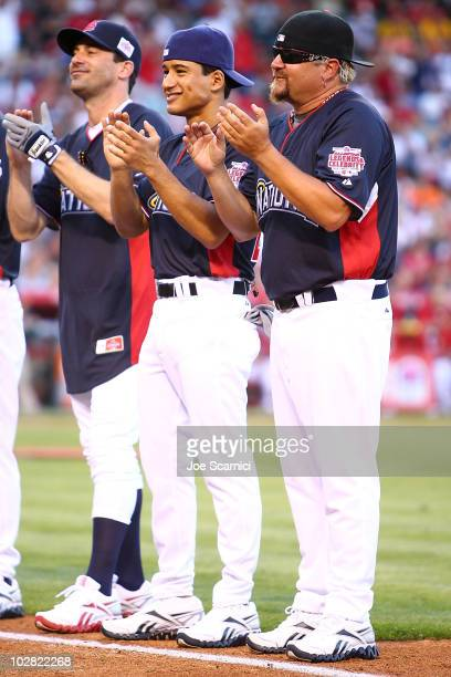 John Hamm Mario Lopez and Guy Fieri get ready before the game at the Taco Bell AllStar Legends Celebrity Softball Game at Angel Stadium of Anaheim on...