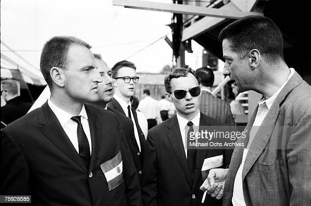 John Hammond speaks to some international attendees of the American Jazz Festival in July 1958 in Newport, Rhode Island. Hammond was a legend in the...