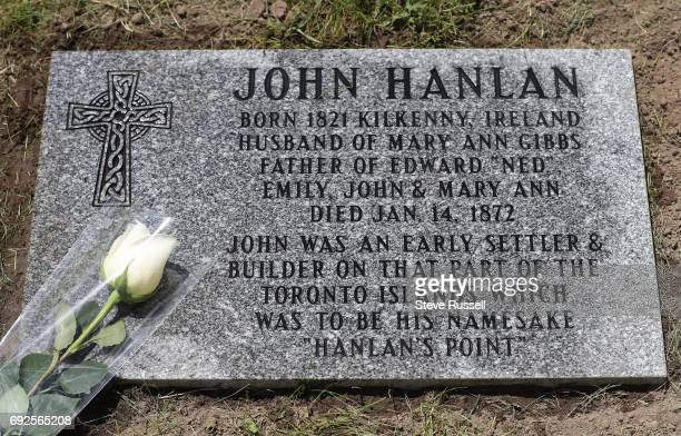 John Hanlan's great, great grandson Ted English is flanked by his daughters and great great great granddaughters to Hanlan at the new marker for his...