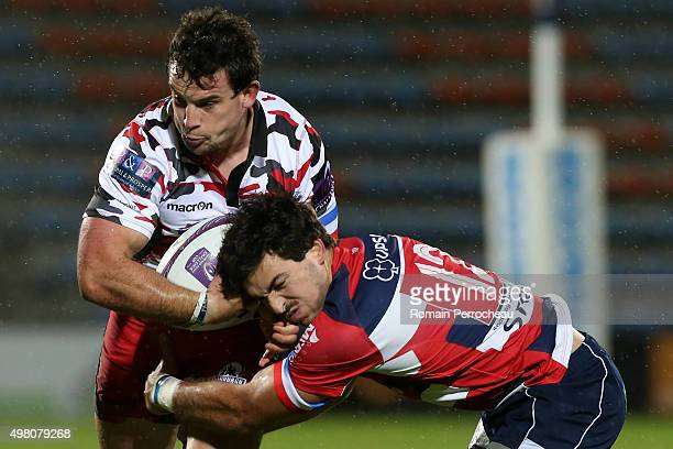 John Hardie for Edimbourg is tackled by Julien Heriteau during the European Rugby Challenge Cup match between Agen and Edimbourg at Stade Armandie on...