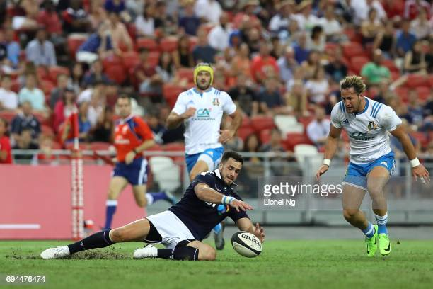 John Hardie of Scotland goes after the ball as Michele Campagnaro of Italy chases in during the International Test match between Italy and Scotland...