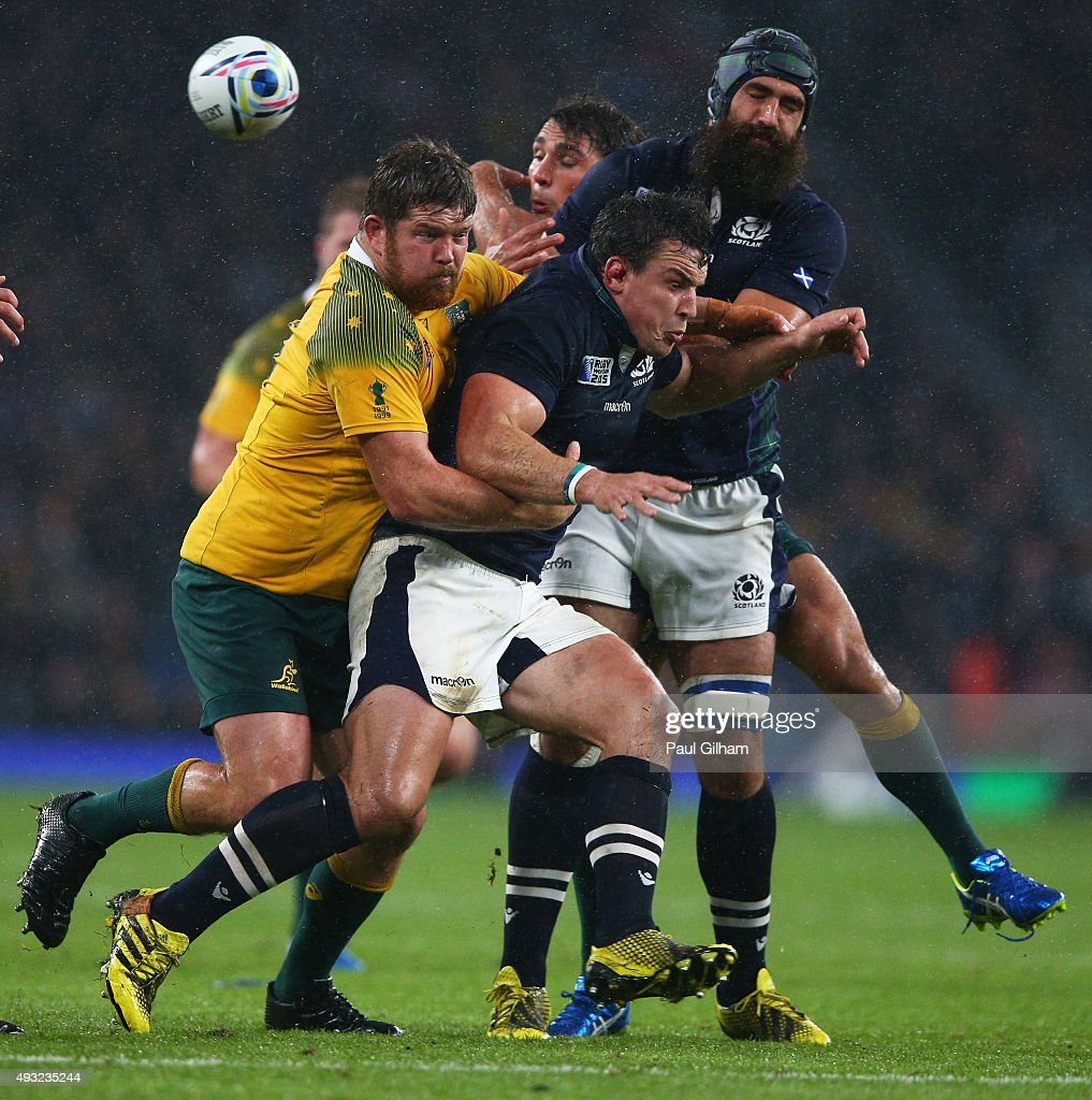 John Hardie of Scotland is tackled by Greg Holmes of Australia, the incident resulted in a match winning penalty being awarded to Australia during the 2015 Rugby World Cup Quarter Final match between Australia and Scotland at Twickenham Stadium on October 18, 2015 in London, United Kingdom.