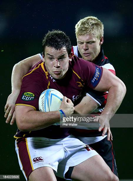 John Hardie of Southland is tackled by Baden Kerr of Counties during the round nine ITM Cup match between Counties Manukau and Southland at ECOLight...