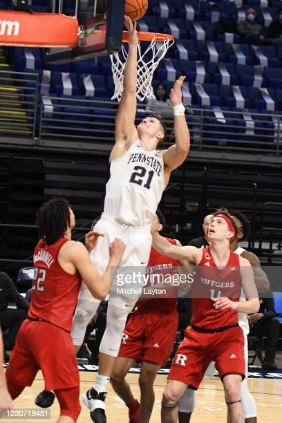 John Harrar of the Penn State Nittany Lions drives to the basket in the first half during a college basketball game against the against the Rutgers...