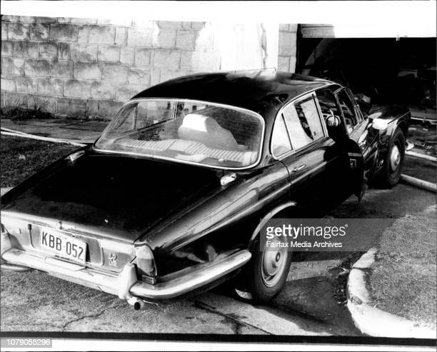 John Harrigan's Jaguar car the driver's door open and the radio turned on straddles the footpath outside his Vaucluse home today