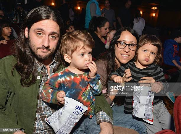 John Harrison and Ahna Tessler with children attend Yo Gabba Gabba Live at The Beacon Theatre on December 21 2013 in New York City