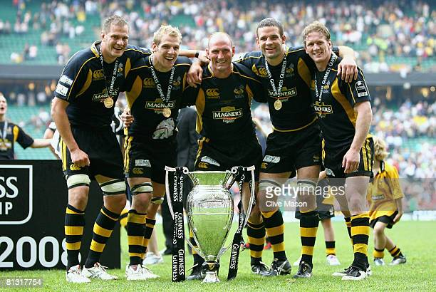 John Hart James Haskell Lawrence Dallaglio Joe Worsley and Tom Rees of Wasps celebrate with the trophy after victory in the Guinness Premiership...