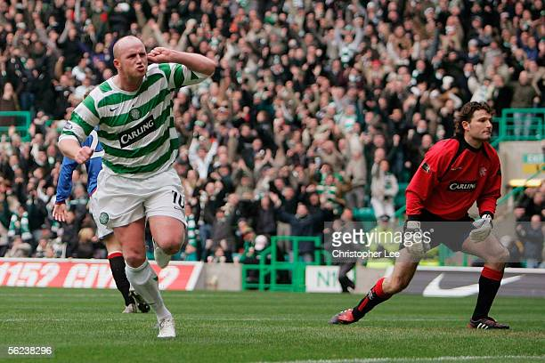 John Hartson of Celtic celebrates scoring their first goal during the Bank of Scotland Scottish Premier League match between Celtic and Rangers at...