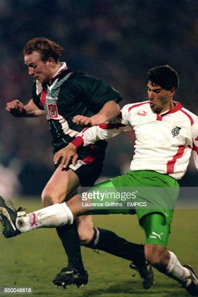 John Hartson tries to get away from Bugaria's Trifon Ivanov