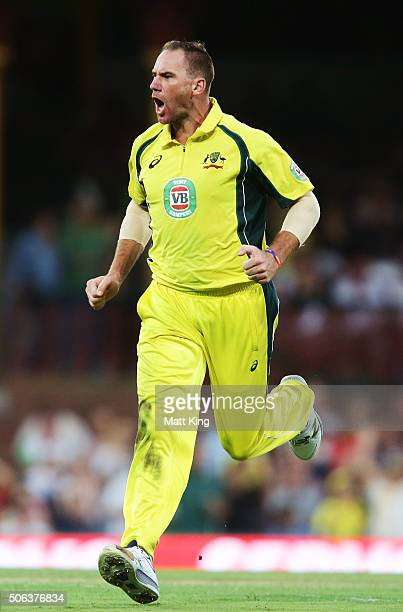 John Hastings of Australia celebrates taking the wicket of Virat Kohli of India during game five of the Commonwealth Bank One Day Series match...