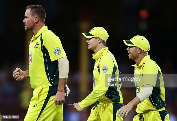 John Hastings of Australia followed by Steve Smith and David Warner celebrates taking the wicket of Virat Kohli of India during game five of the...