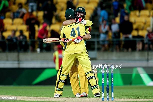 John Hastings of Australia hugs team mate Mitchell Marsh after game two of the one day international series between New Zealand and Australia at...