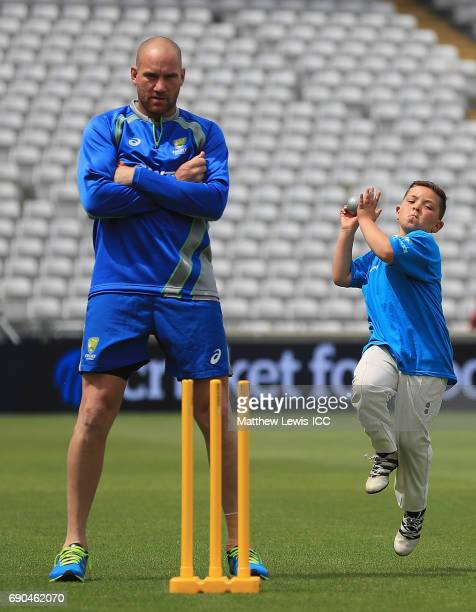 John Hastings of Australia looks on as a local school child bowls during the ICC Champions Trophy Cricket for Good clinic with Australia at Edgbaston...