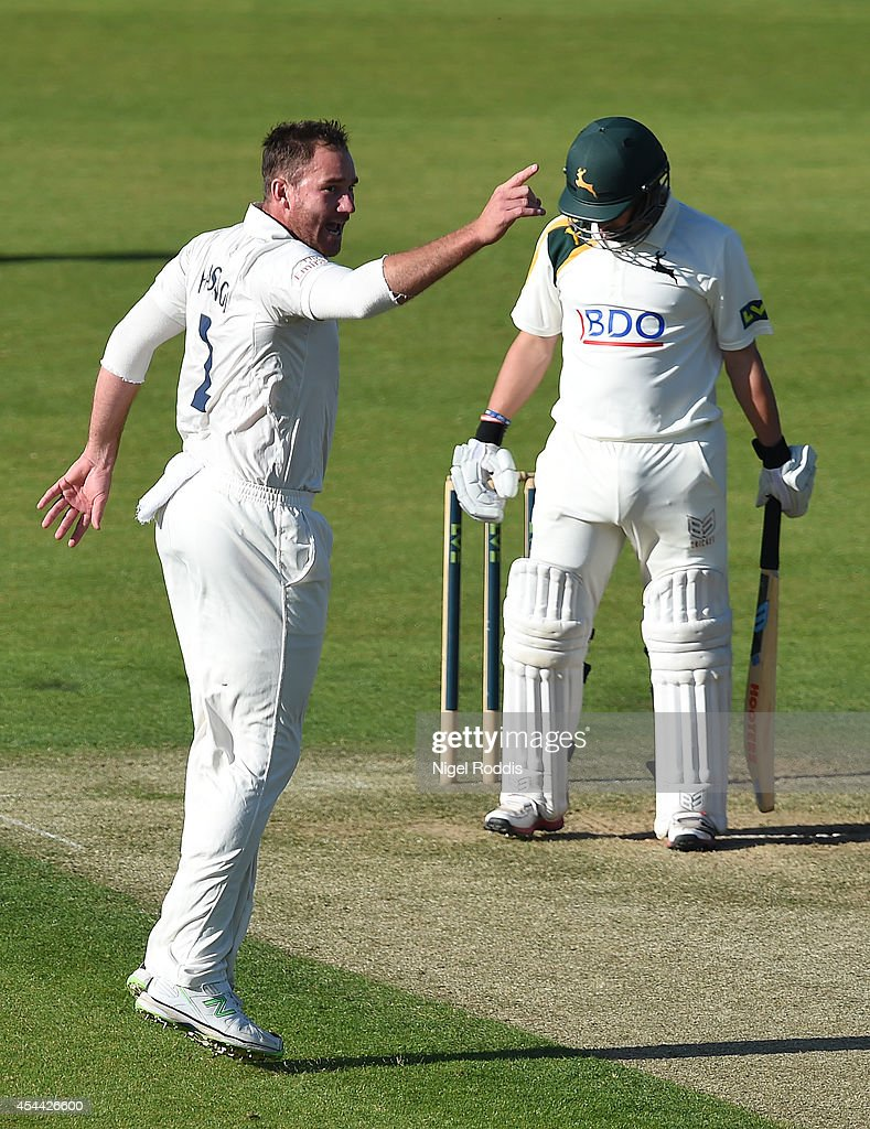 John Hastings (L) of Durham celebrates taking the wicket of Steven Mullaney of Nottinghamshire during the LV County Championship match between Durham and Nottinghamshire at The Riverside on August 31, 2014 in Chester-le-Street, England.