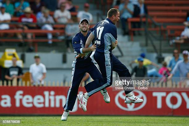 John Hastings of the Bushrangers celebrates the wicket of Blue's Sean Abbott with teammate Glenn Maxwell during the Matador BBQ's OneDay Cup between...