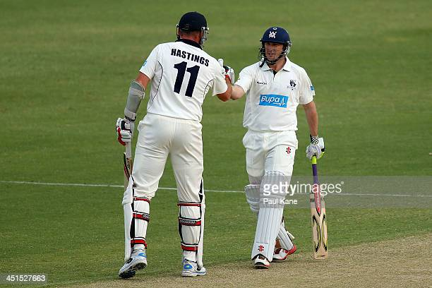 John Hastings of the Bushrangers congratulates David Hussey after scoring his half century during day two of the Sheffield Shield match between the...