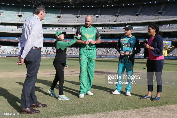 John Hastings of the Stars and Brendan McCullum view the coin toss during the Big Bash League match between the Melbourne Stars and the Brisbane Heat...