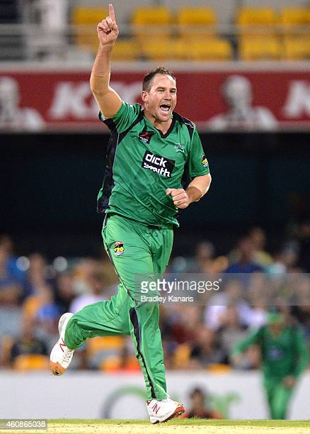 John Hastings of the Stars celebrates after taking the wicket of Chris Lynn of the Heat during the Big Bash League match between the Brisbane Heat...