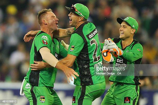 John Hastings of the Stars celebrates winning after his super over with Kevin Piertersen and Tom Triffitt during the Big Bash League match between...
