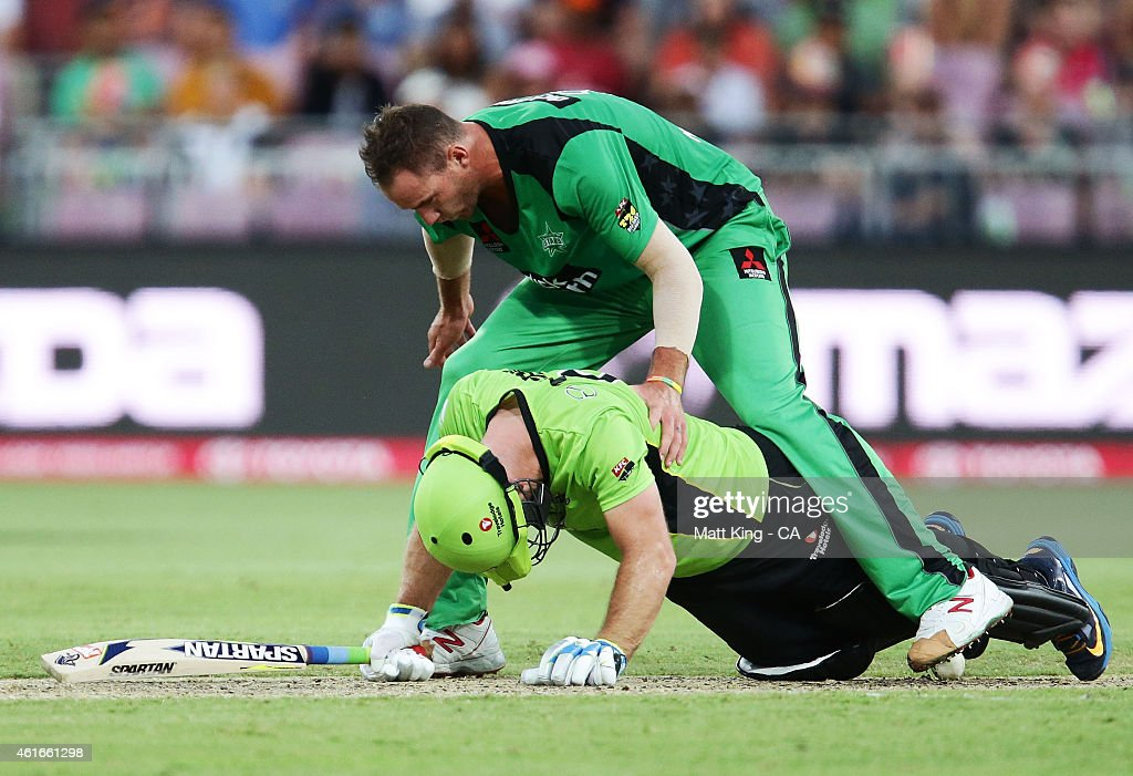 John Hastings of the Stars climbs over Aiden Blizzard of the Thunder to get the ball during the Big Bash League match between the Sydney Thunder and the Melbourne Stars at Spotless Stadium on January 17, 2015 in Sydney, Australia.