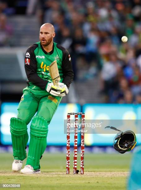 John Hastings of the Stars is hit by a bouncer bowled by Ben Cutting of the Heat and has his helmet knocked off his head during the Big Bash League...