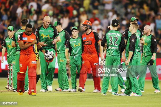 John Hastings of the Stars looks dejected after defeat as Seb Gotch of the Stars hugs Cameron White of the Renegades during the Big Bash League match...