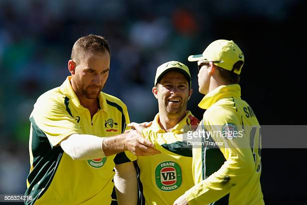 John Hastings reaches out to shake the hand of Steve Smith of Australia after he took the catch to dismiss Ajinkya Rahane of India during game three...