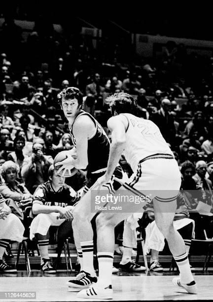 John Havlicek Forward of the Boston Celtics maneuvers against Dave DeBusschere Power Forward of the New York Knicks during an NBA basketball game in...