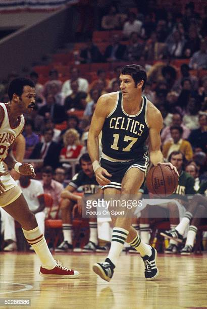John Havlicek of the Boston Celtics dribbles downcourt against the Atlanta Hawks during a game at the Alexander Memorial Coliseum circa 1970's in...