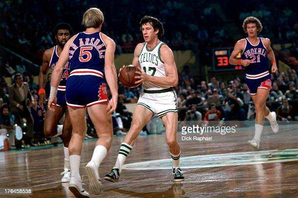 John Havlicek of the Boston Celtics drives to the basket against Dick Van Arsdale of the Phoenix Suns during a game played circa 1977 at the Boston...