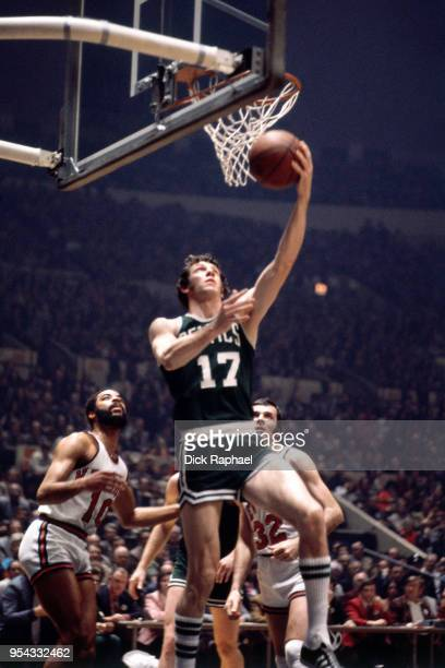 John Havlicek of the Boston Celtics goes to the basket against the New York Knicks circa 1970 at Madison Square Garden in New York City New York NOTE...