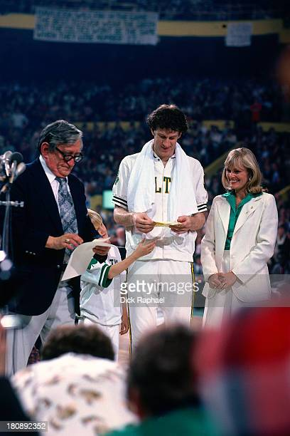 John Havlicek of the Boston Celtics is honored along with his family during halftime of his last game of professional basketball after 16 years with...