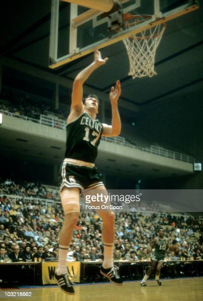 John Havlicek of the Boston Celtics lays the ball up on a break away against the Washington Bullets circa 1971 during an NBA basketball game at the...