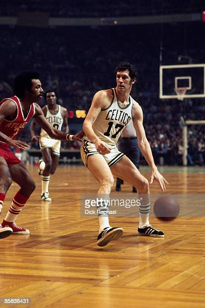 John Havlicek of the Boston Celtics moves the ball up court against Herm Gilliam of the Atlanta Hawks during a game played in 1973 at the Boston...