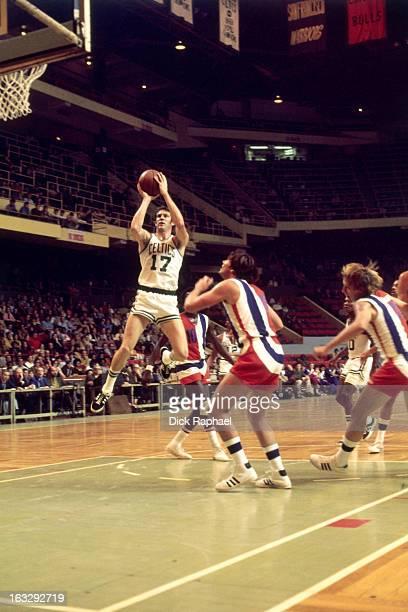 John Havlicek of the Boston Celtics shoots against the Baltimore Bullets circa 1971 at the Boston Garden in Boston Massachusetts NOTE TO USER User...