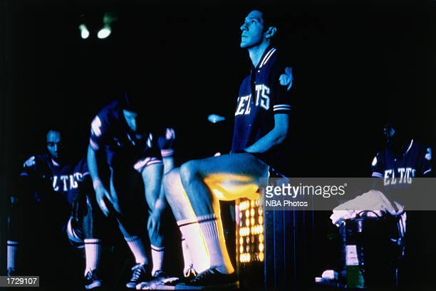 John Havlicek of the Boston Celtics sits on the shot clock during an NBA game at the Boston Garden in Boston Massachusetts NOTE TO USER User...
