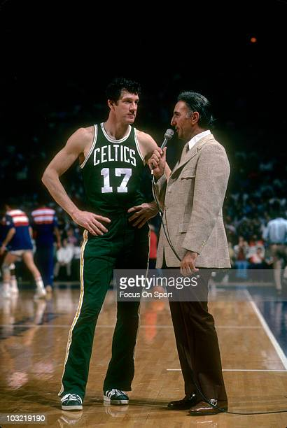 John Havlicek of the Boston Celticsleft is being interviewed by former Celtic Bob Cousy right circa 1973 before an NBA basketball game between the...