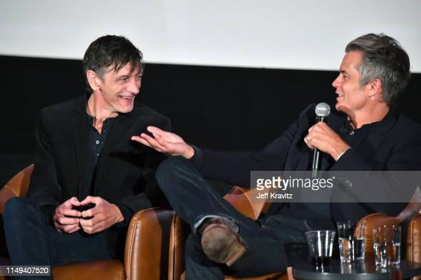 John Hawkes and Timothy Olyphant speak onstage at HBO's 'Deadwood' FYC screening at Arclight Hollywood on May 15, 2019 in Los Angeles, California.